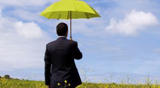 man holds yellow umbrella
