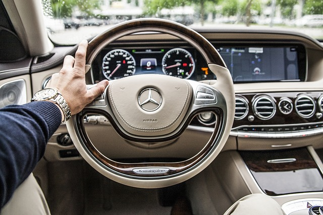 first person view of driving a Mercedes